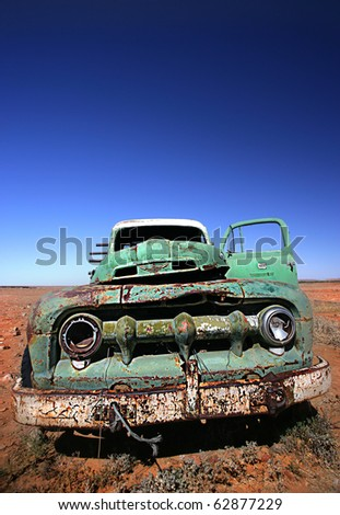 old car in a desert - stock photo
