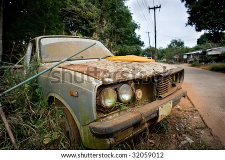 Old car on the roadside - stock photo