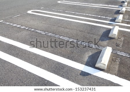 Old Car parking lot with white mark  - stock photo