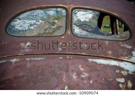 Old car rear windows very rusted panels in light blue