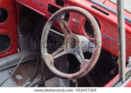 Old car steering wheel - stock photo