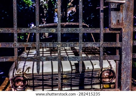 old car through the bars - stock photo
