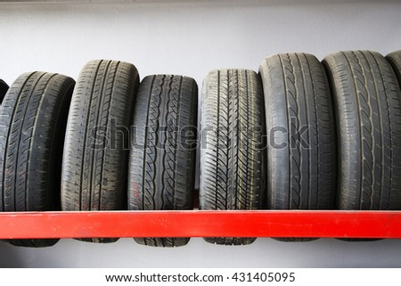 Old Car tires on rack. - stock photo