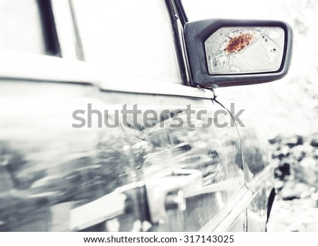 Old car with broken mirror  - stock photo