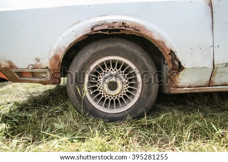 old car with rust on body close up - stock photo