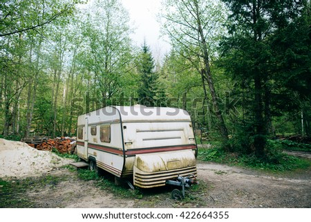 Old Caravan trailer in mountain green forest