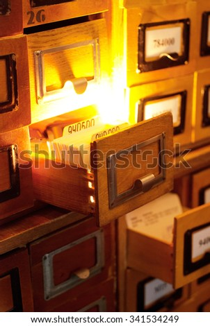 old card index with cards in the library with the glowing box - stock photo