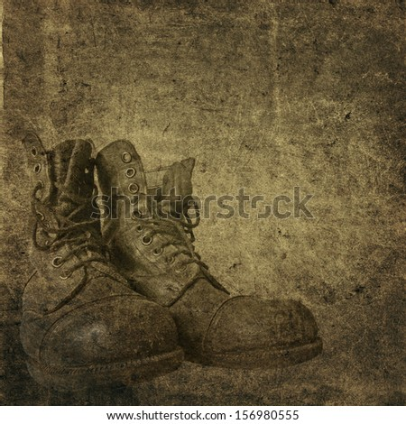 Old card with a picture of a boot - stock photo
