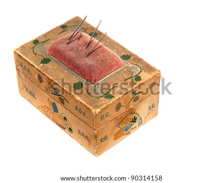 Old cardboard sewing needle box with built-in pincushion, white isolation. - stock photo