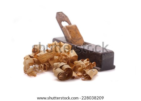 old carpenter plane and wood shavings isolated on white - stock photo