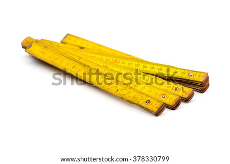 Old carpentry ruler isolated on white - stock photo