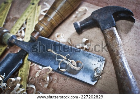 Old carpentry tools on a wooden table