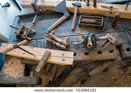 Old carpentry workshop with obsolete tools used. Vintage woodworking hand tools of an ancient carpentry.