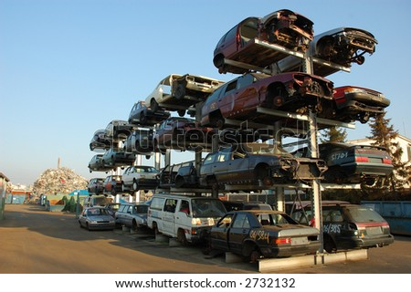Old cars for recycling on the scrap yard - stock photo