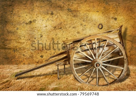 Old cart in a barn - stock photo