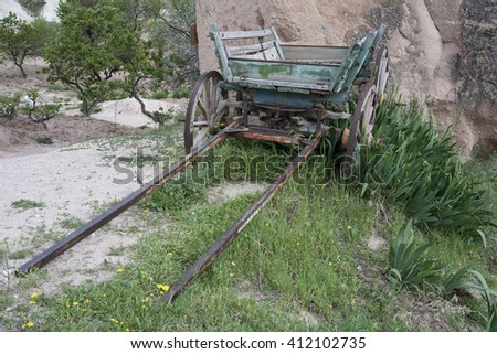 Old cart overgrown with grass. Cappadocia. Turkey.