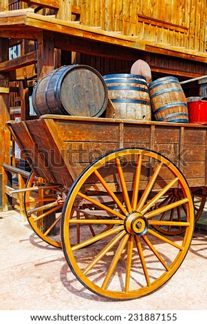 Old cart with wine barrels.Wild West.  - stock photo