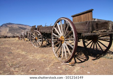 Old carts near Cody Wyoming in a Ghost town - stock photo