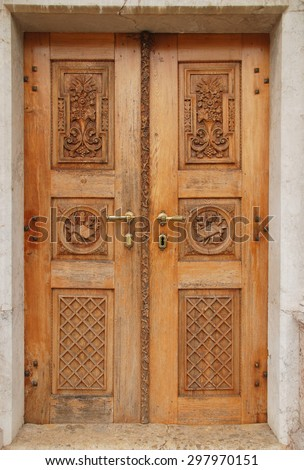 Old carved wooden church door Slovenia - stock photo