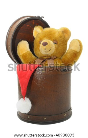 Old case with chrismas hat and teddy bear isolated against a white background
