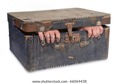 Old case with hands hanging out - stock photo