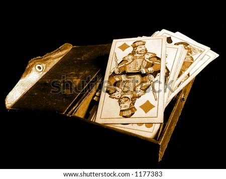 Old casino cards and card-box on black background. - stock photo