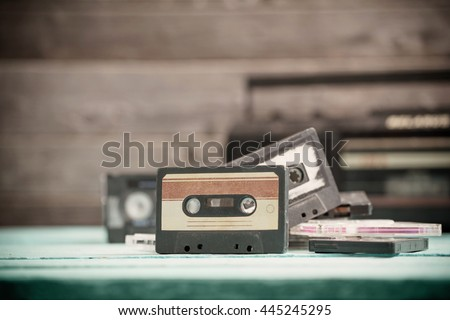 old cassette tape and player on the wood background - stock photo