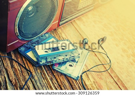 old cassette tape and player on the wood background ,vintage style - stock photo