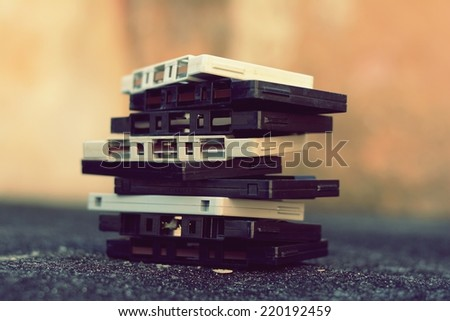 Old cassettes stacked on each other - stock photo