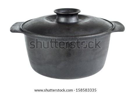 Old cast iron cooking pot , isolated on white - stock photo