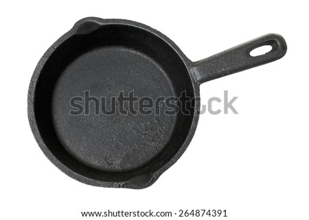 Old cast-iron frying pan isolated on a white background - stock photo