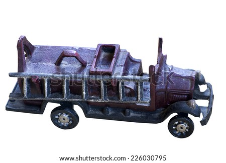 Old Cast Iron Toy Fire Truck on a white background - stock photo