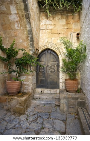 Old castle door at the old town (medieval city) of Rhodes, Greece