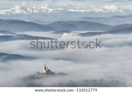 Old castle in the fog - stock photo