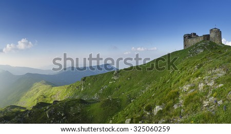 Old castle of observatory on the top of mountain range, travel natural background, panoramic view - stock photo