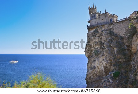 old castle on rock over the sea - stock photo