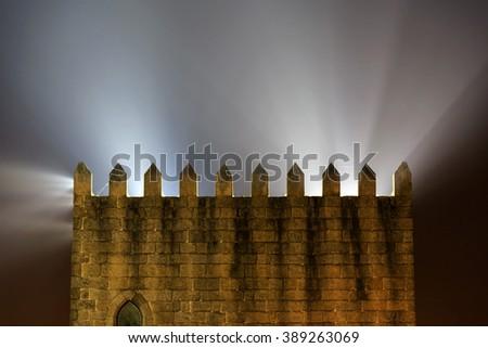 Old castle wall with illumination in Porto, Portugal - stock photo
