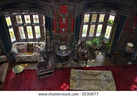 Old castle with antique furniture - stock photo