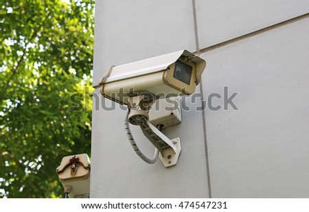 old cctv camera on wall