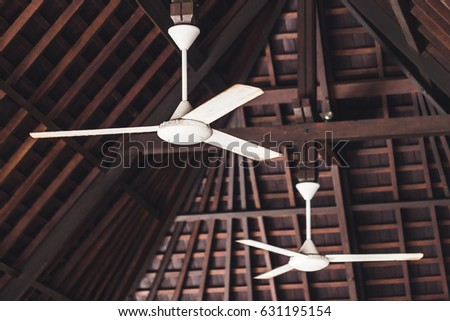 Old ceiling fan hanging under wooden stock photo 631195154 old ceiling fan hanging under wooden roof asian style aloadofball Images