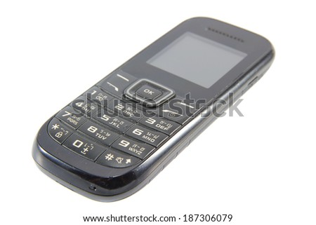 Old cell phone on a white background. - stock photo
