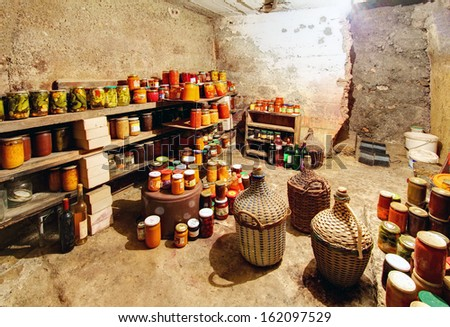 Old Cellar and a many preserves - stock photo