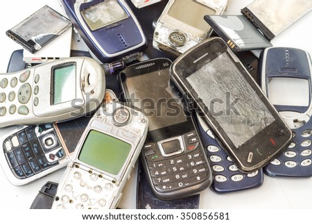 Old cellphones and battery - Electronic waste concept
