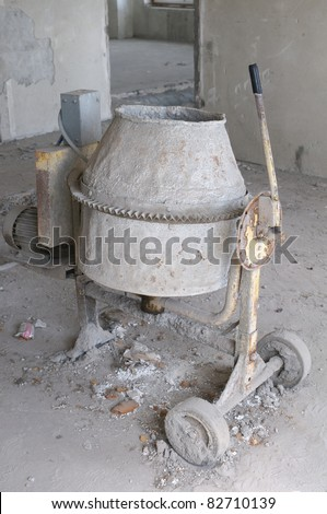 Old cement mixer - stock photo