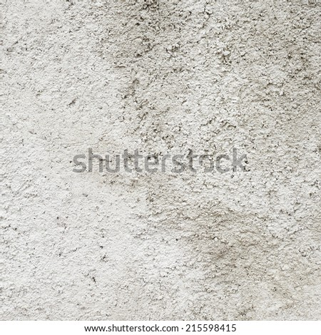 Old cement wall fragment as an abstract grungy background composition - stock photo