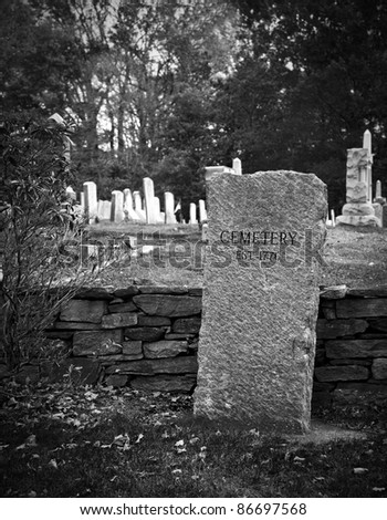 Old cemetery in fall in black and white - stock photo
