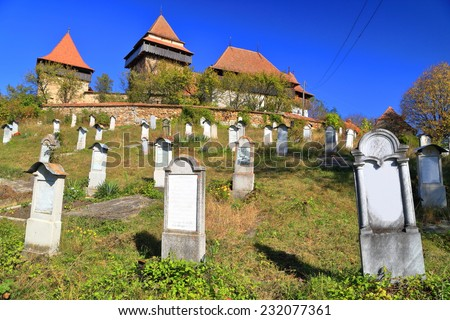 Old cemetery of the fortified church from UNESCO world heritage list in Viscri village, Transylvania, Romania - stock photo