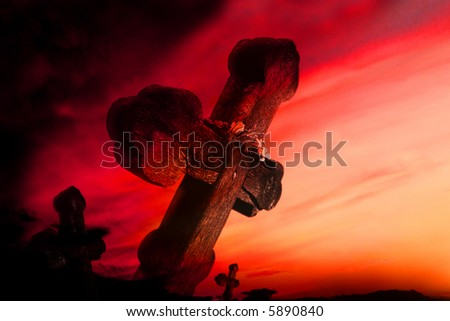 Old cemetery on the sunset background. - stock photo