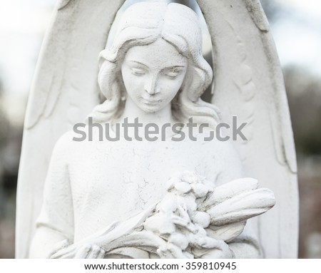 Old cemetery sculpture of the young girl. - stock photo