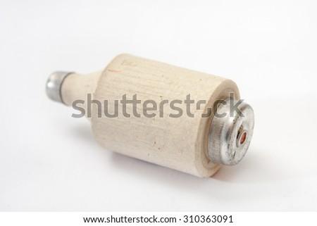 Old ceramic fuse on the white background. - stock photo